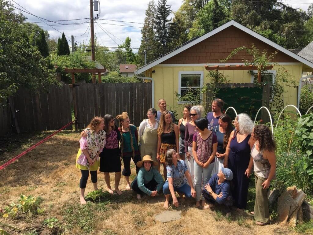 Eugene Yoga's staff in the studio garden